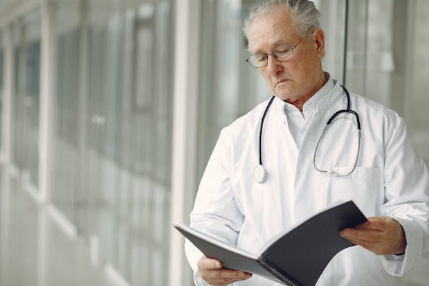 A doctor looking at a file